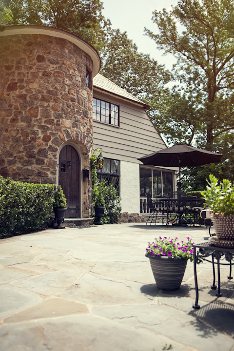 Larchmont Tudor's color scheme was launched by the home's natural elements.