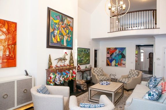 Color scheme designed to allow art to take center stage in this comfortable Bedford family Room.