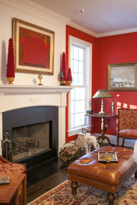 Bright red walls enliven the space, especially because it is flanked by the white Potting Porch and a white Game Room, beyond.