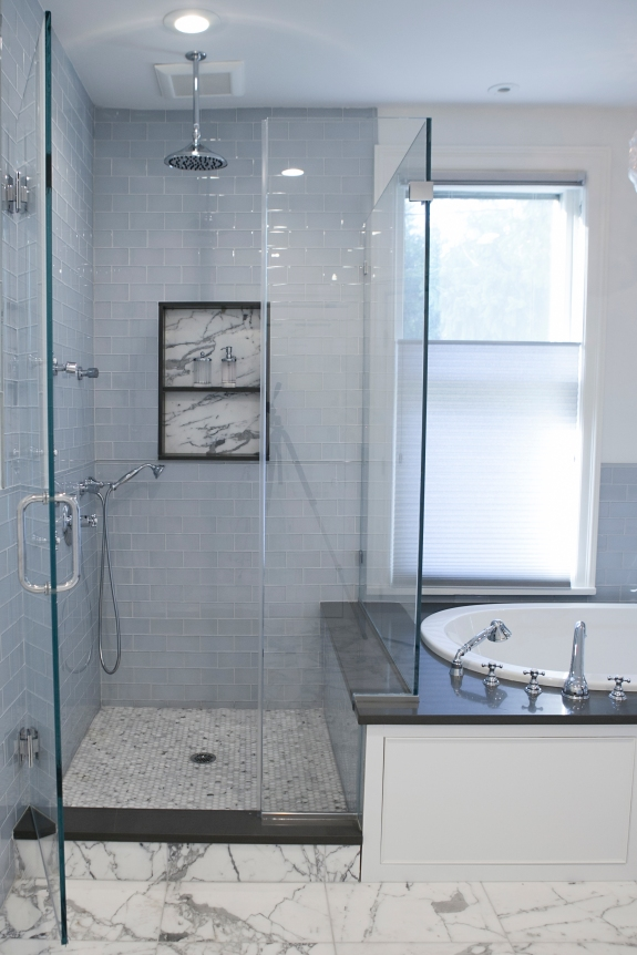 Calacatta Gold marble combines with clear blue glass in spacious Master Bath.