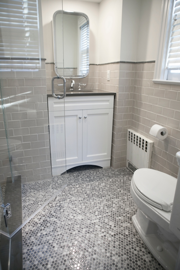 Pennyrounds and grey subway tile in Larchmont Boys' Bath.