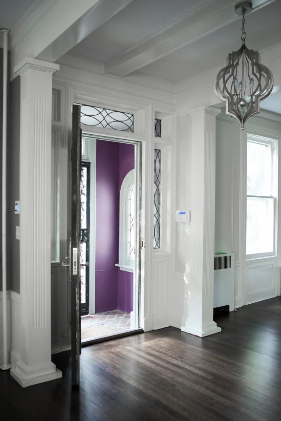 Entry Foyer openwork lighting mimics scrolled iron front door.