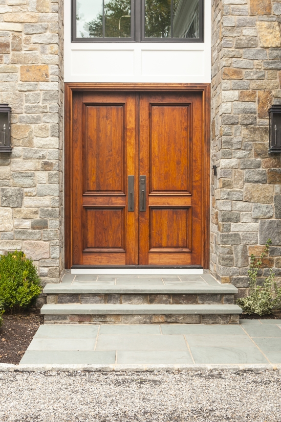 Double-Height Natural Mahogany Door, set in stone.