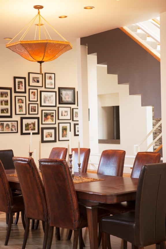 Graphic Deign: Suspended staircase, painted dark, introduces bold graphics into Weston, Connecticut Dining Room.