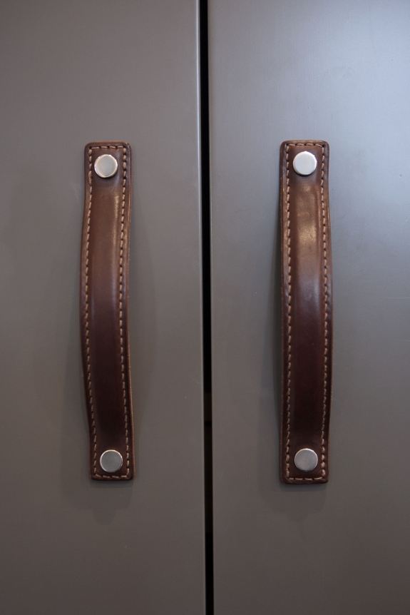 Leather Hardware Detail, on Closet Doors for Him.