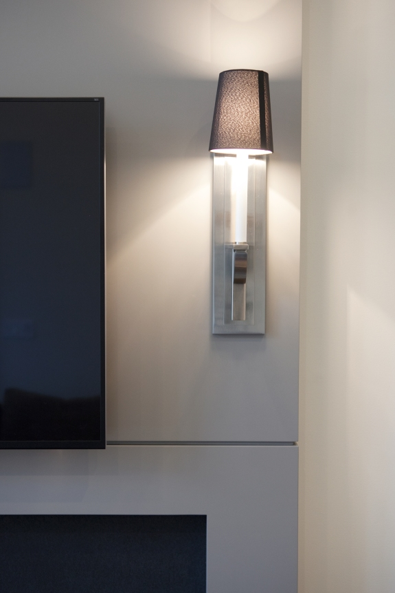 Fireplace Detail: graceful, elongated sconce lighting.