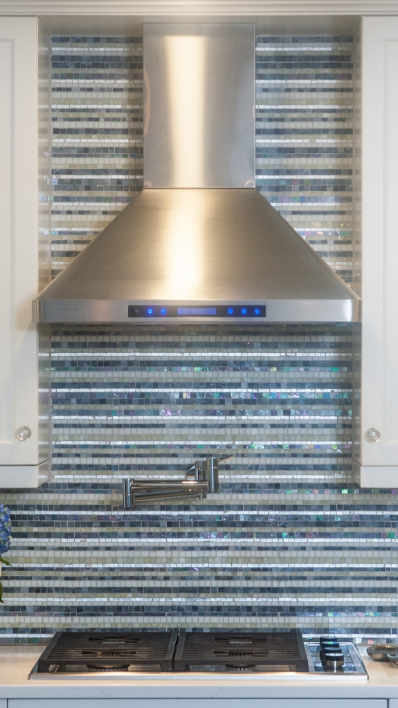 Glass and Mother-of-Pearl Mosaic as Backsplash in Hartsdale, New York Kitchen.